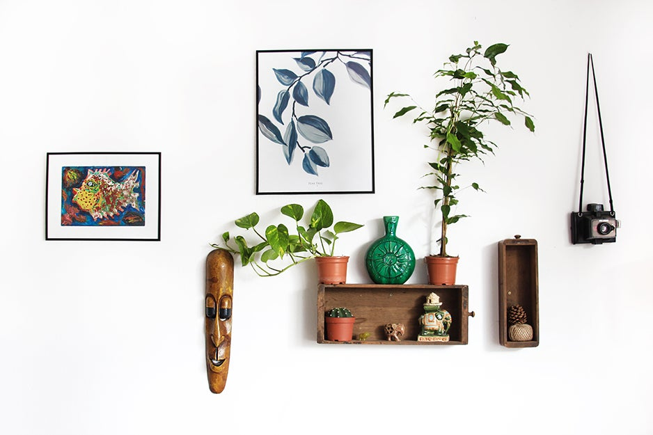 shelf and pictures on a wall