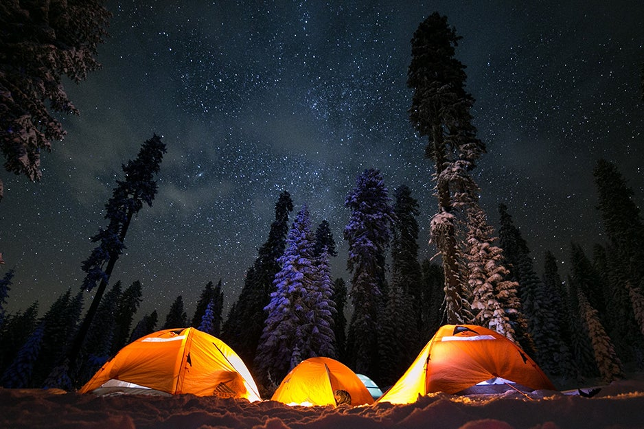 three tents at night with lights