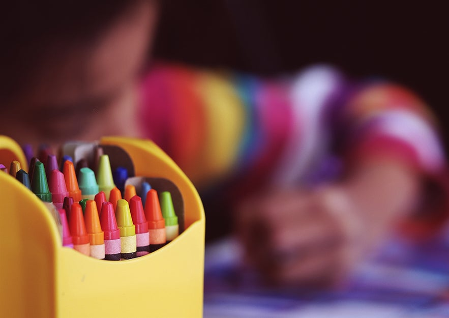 crayons with a child drawing