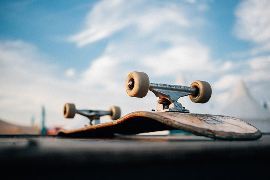 skateboard on the ground with sky in the background