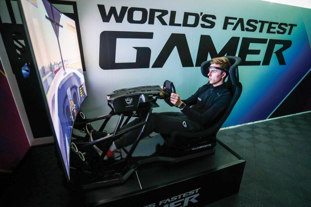 James Baldwin practicing in a racing simulator