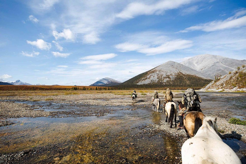American hunters on horseback through the Yukon