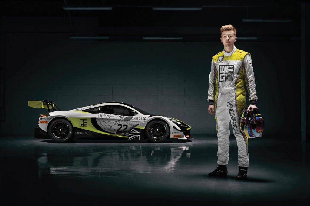 James Baldwin standing in front of a McLaren