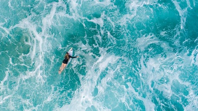 Surfers are riding a wave of new technologies to their Olympic debut