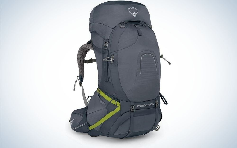 A bag that is carried on the back with two arms and a strong gray color and with pockets and chains on its side.