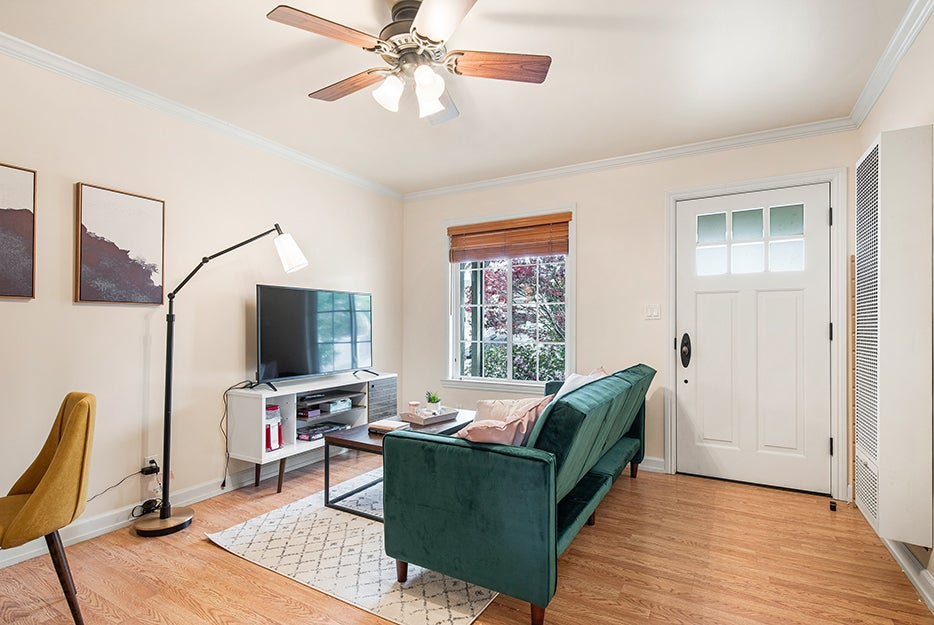 living room with a ceiling fan