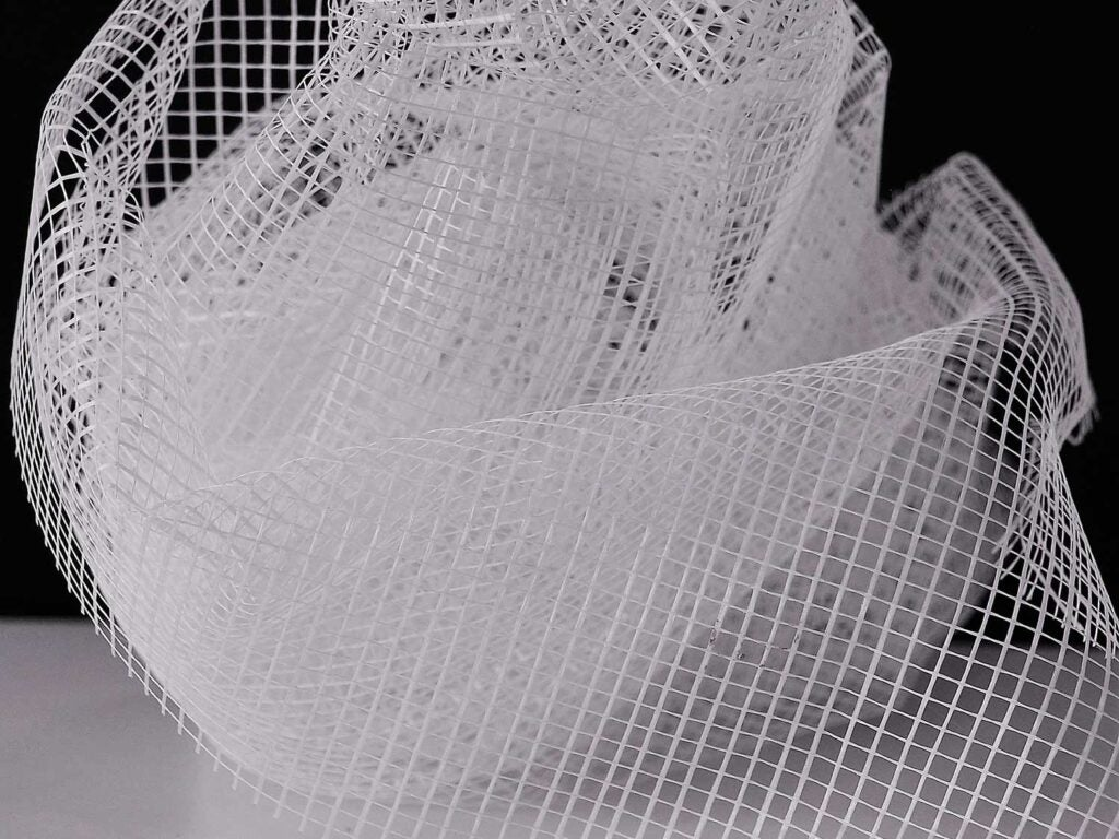 A mosquito net on a black background.