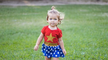 A toddler dressed as Wonder Woman