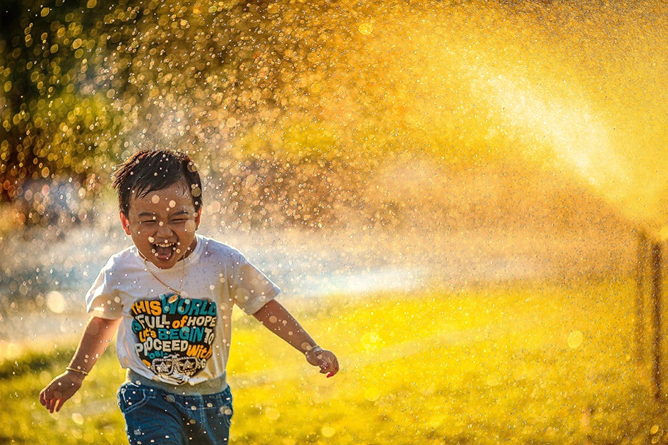 kid laughing backyard