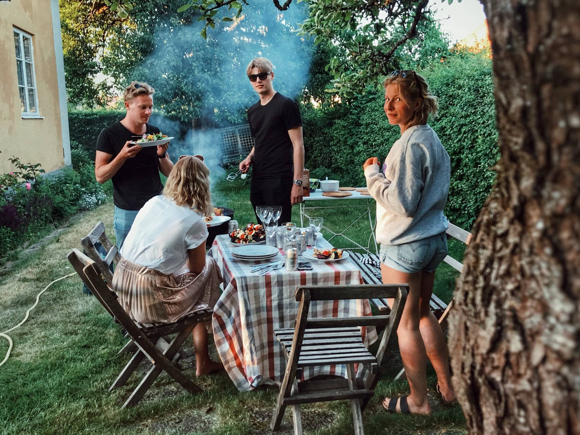 People having an outdoor barbecue