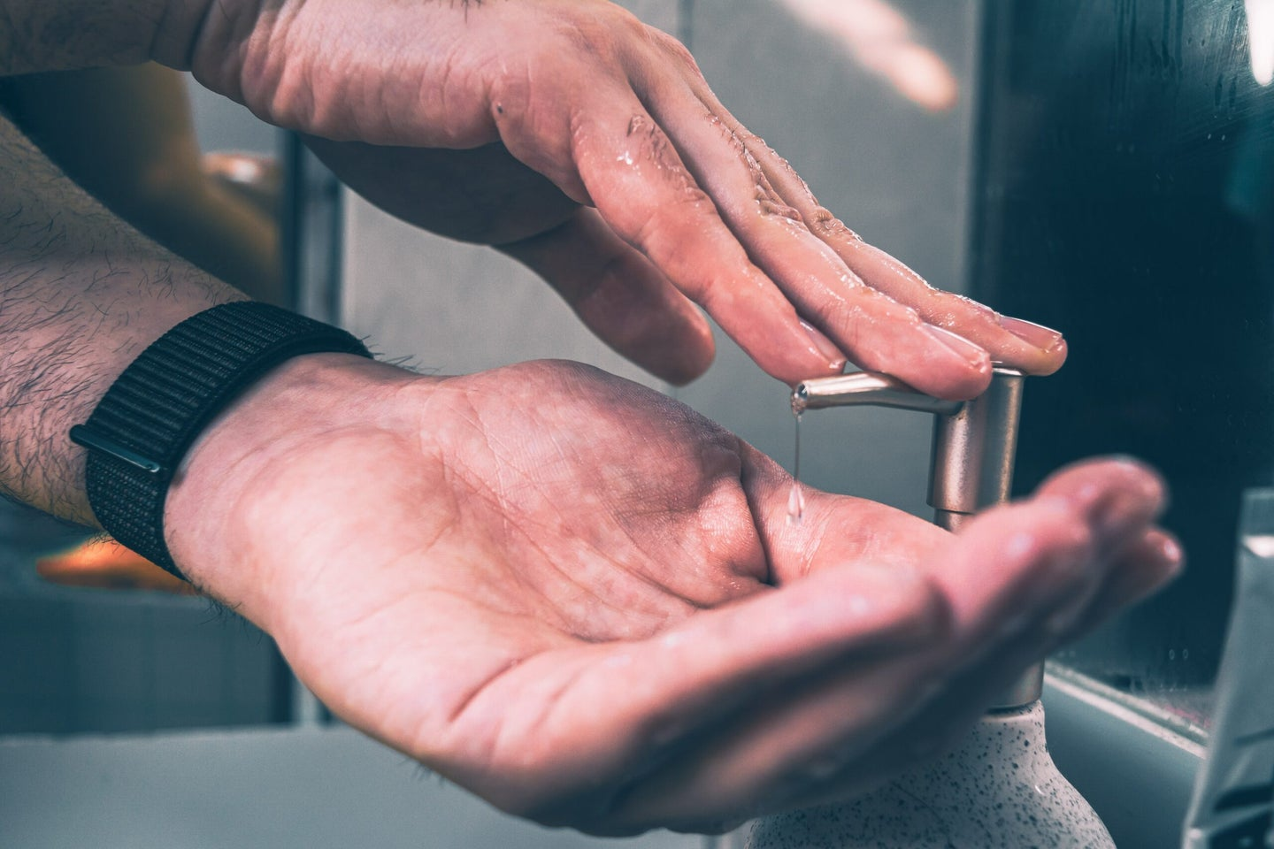 person putting soap on hands