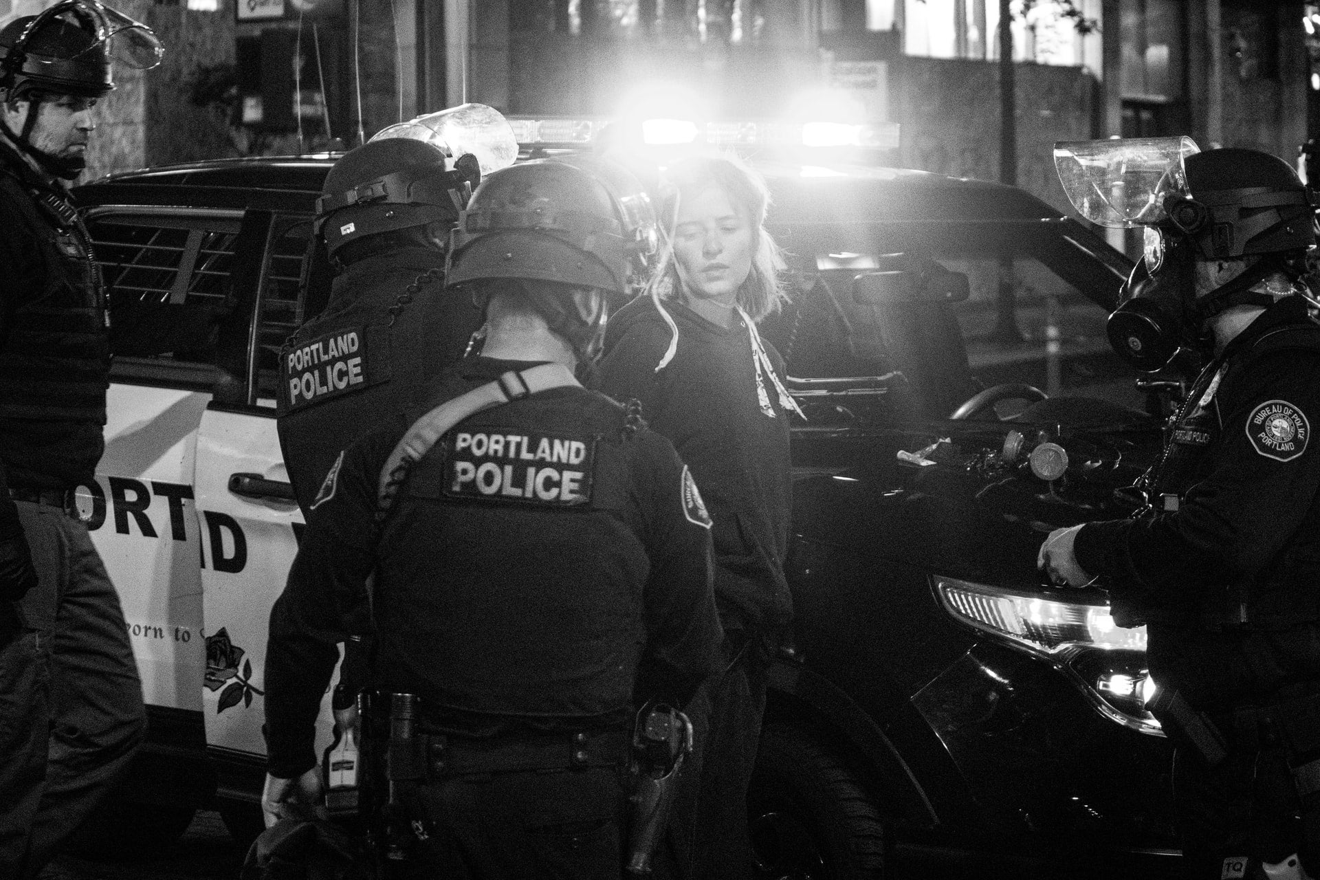 A protester in Portland getting arrested by the city's police department