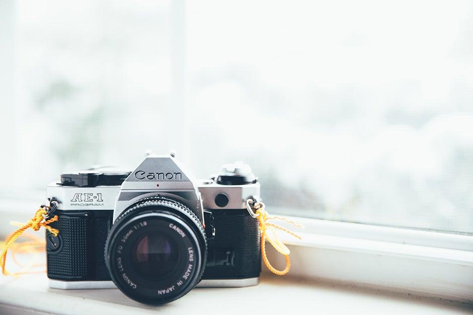 Canon camera on a shelf