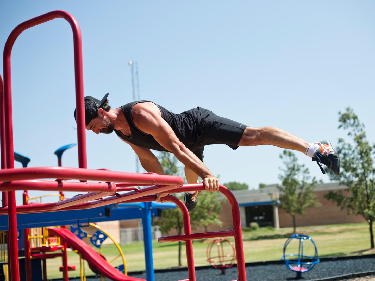 a man doing a strength exercise on a playground