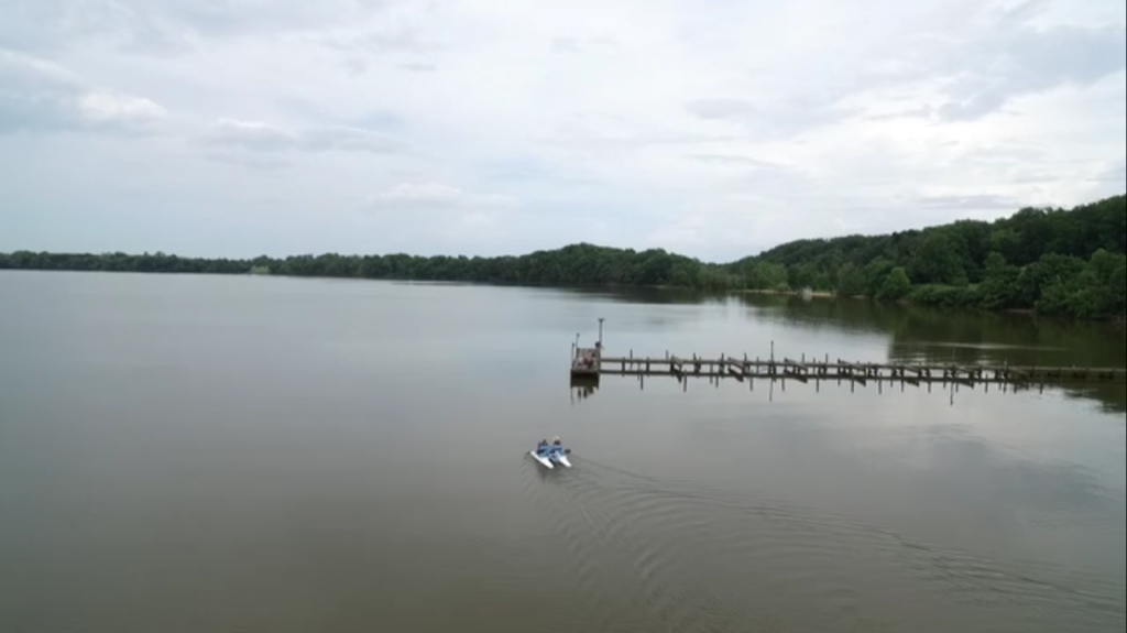 A drone view of Riti and his wife on the boat