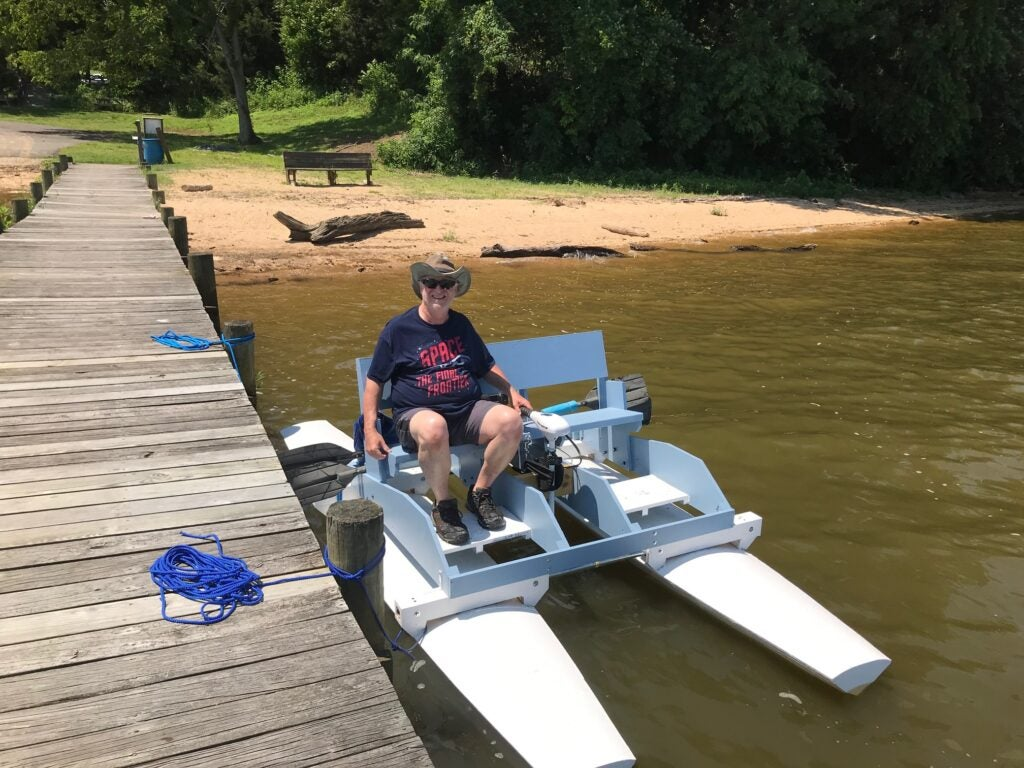 Tom Riti of Port Royal, VA, on the pontoon boat that he build from scratch from an August 1948 Popular Science article.