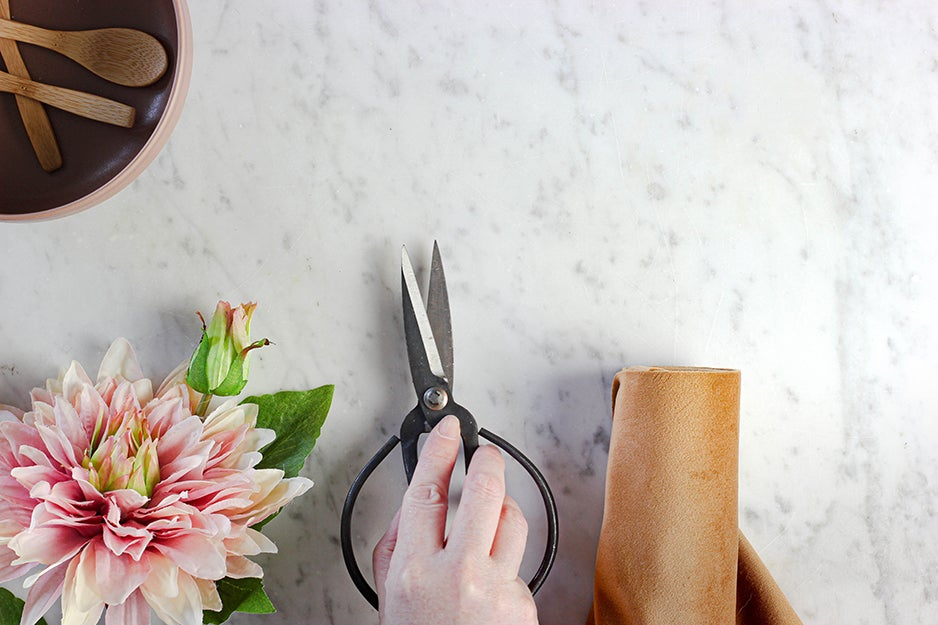 person with kitchen shears