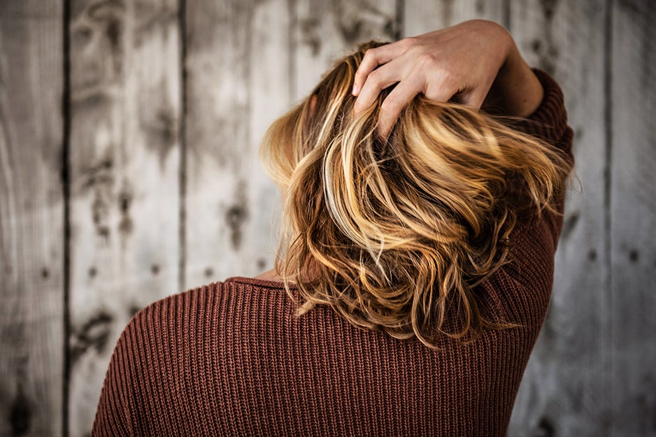 person with hand in hair
