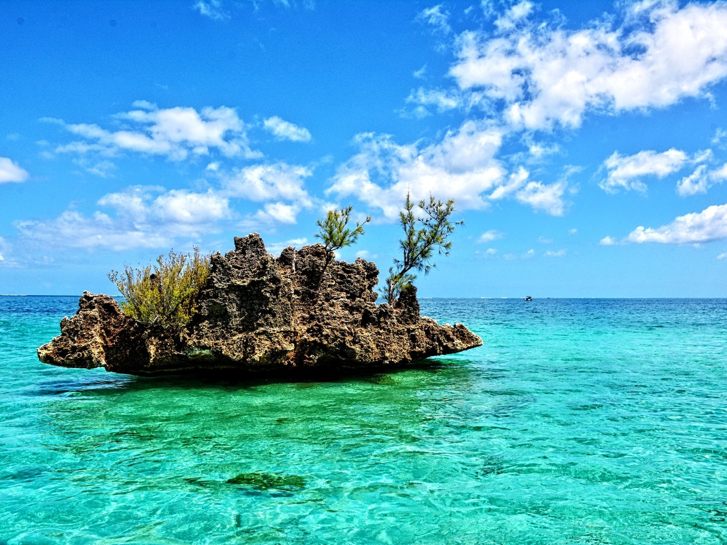 rocky outcropping in very blue tropical waters