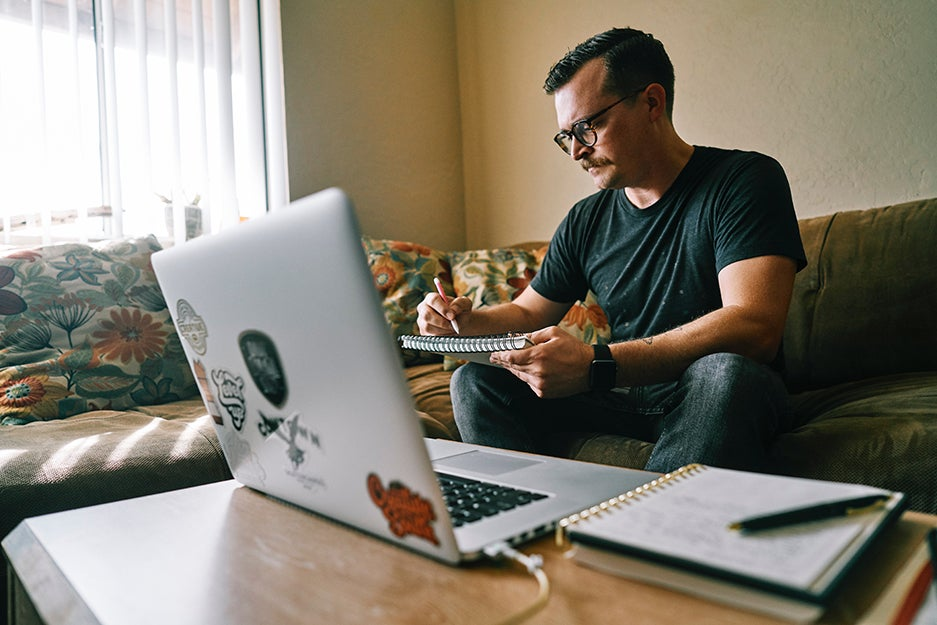 person near laptop on couch