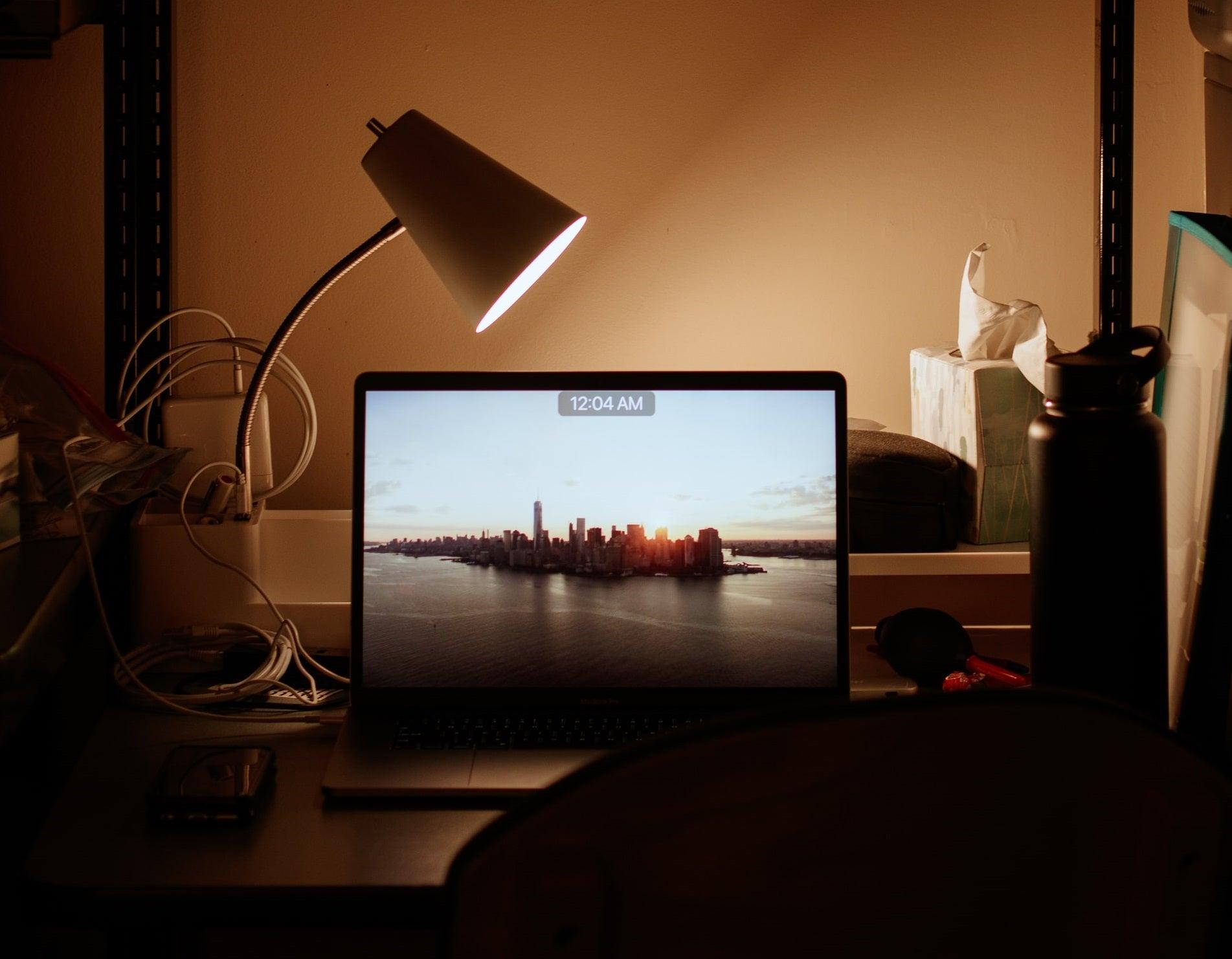 A laptop on a college-dorm desk