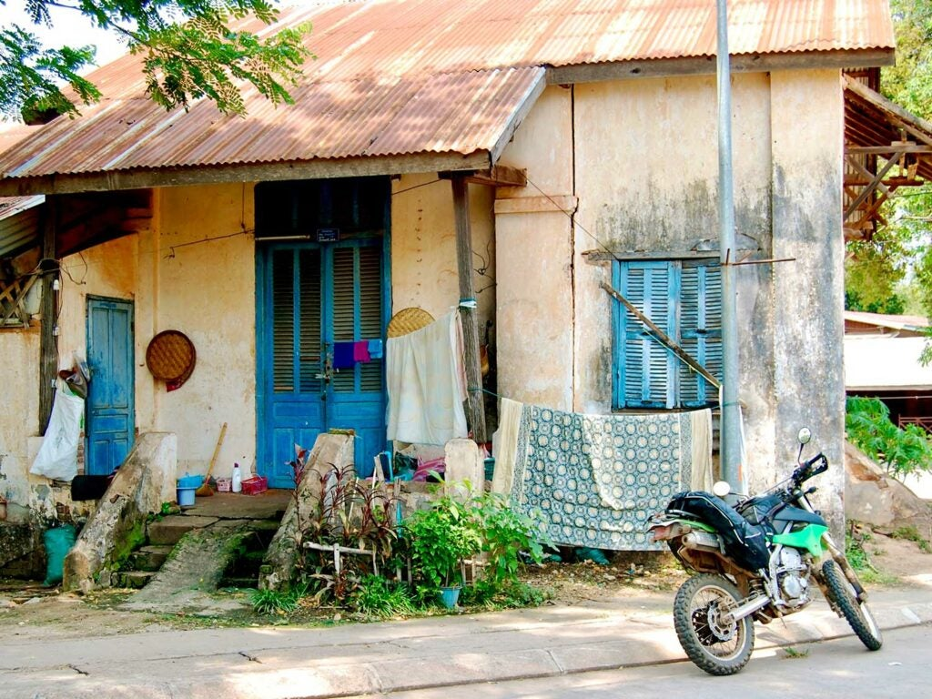 Don't worry, feeling like you're a crazy person for even attempting a solo motorcycle trip is normal. Thakhek, Laos.