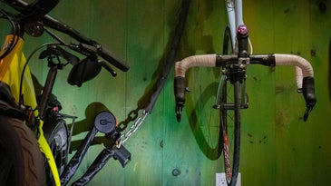 hanging bikes on a wall and locking them
