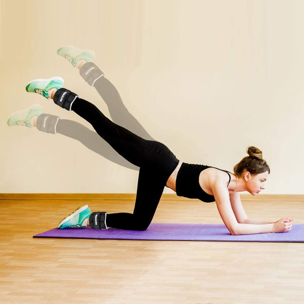 person with ankle weights on yoga mat