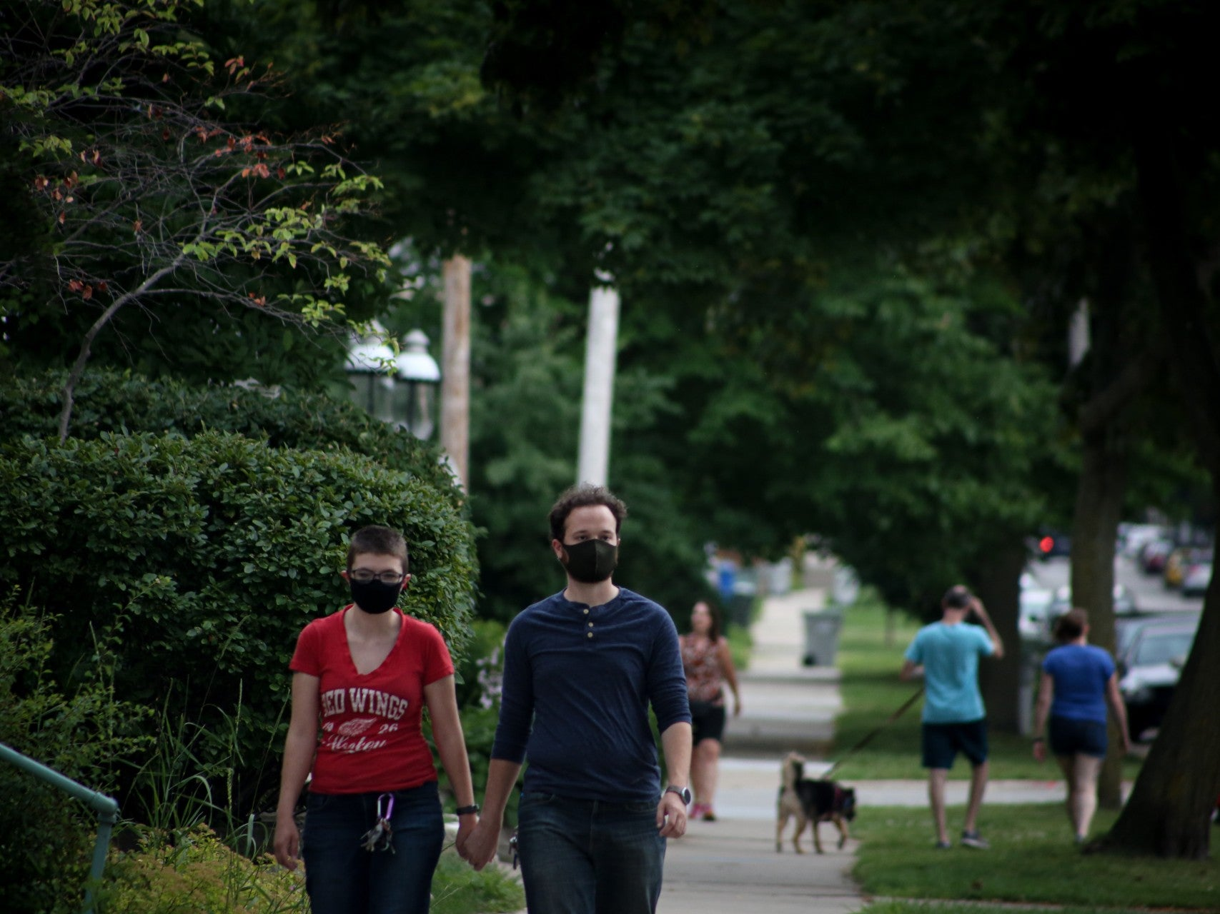 people walking around with masks in the suburbs