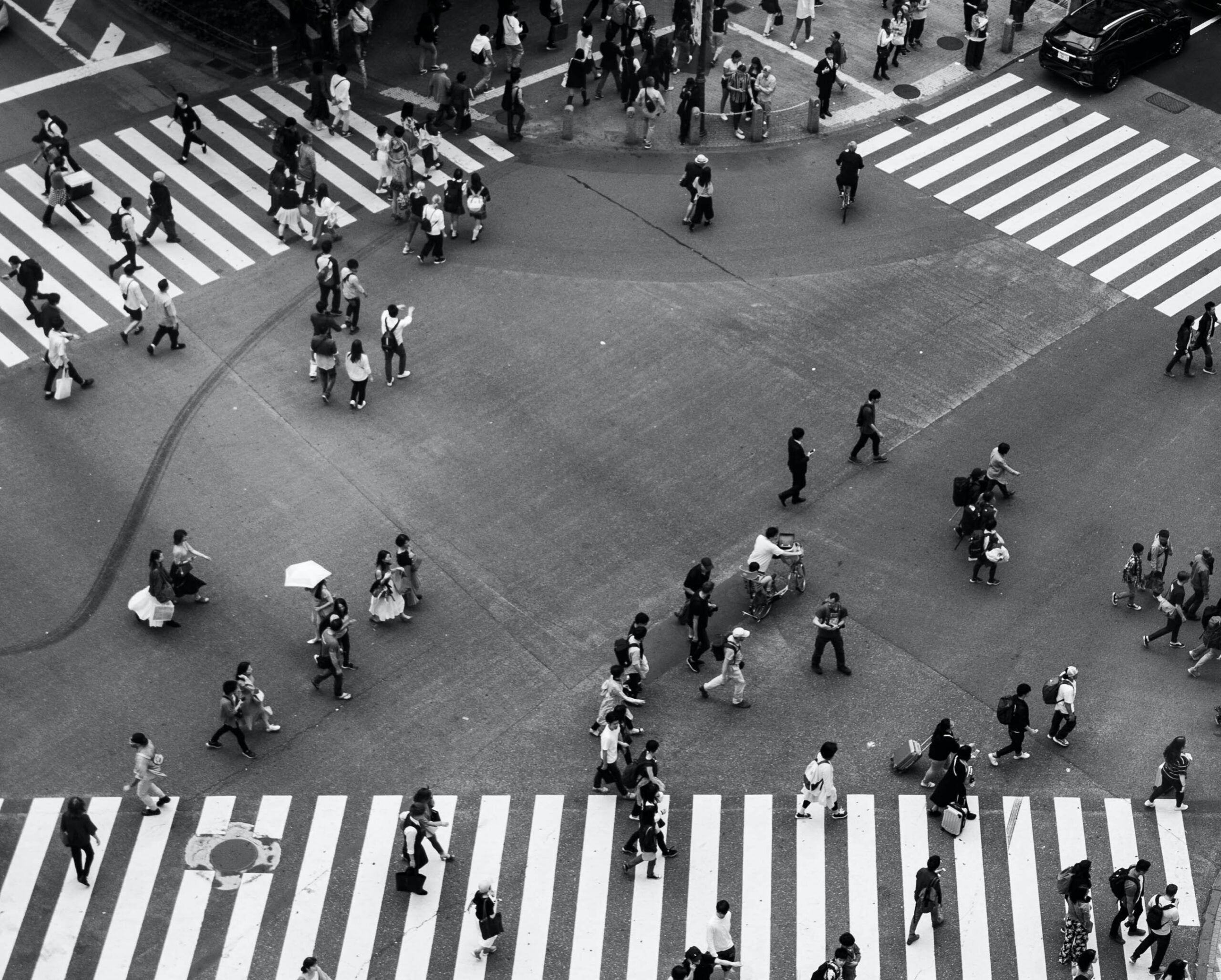 intersection in a city with people crossing