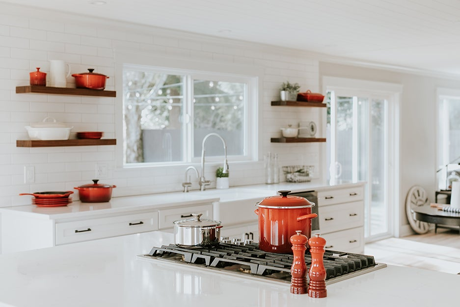 kitchen with red pots and pans
