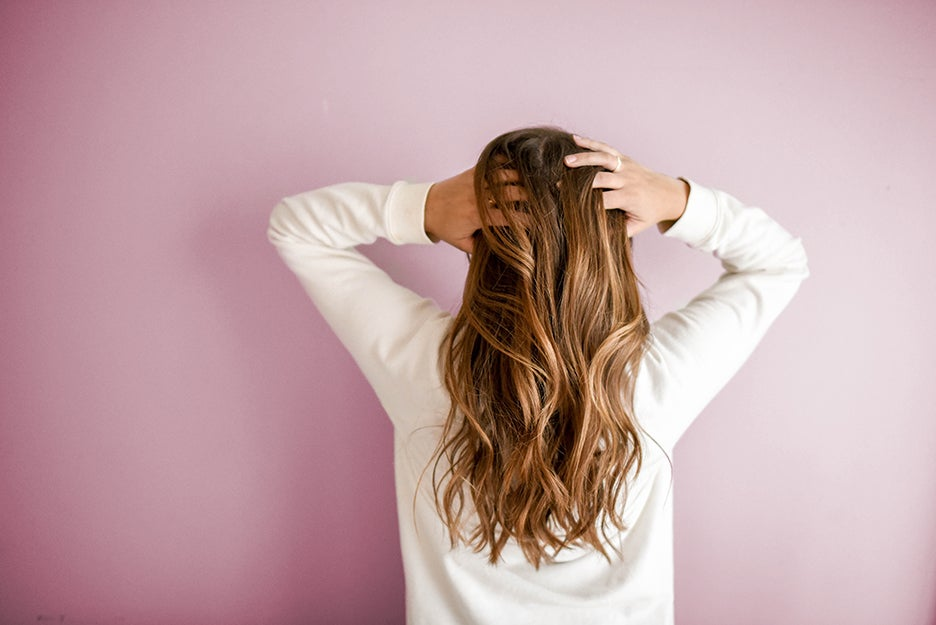 person with hands in hair