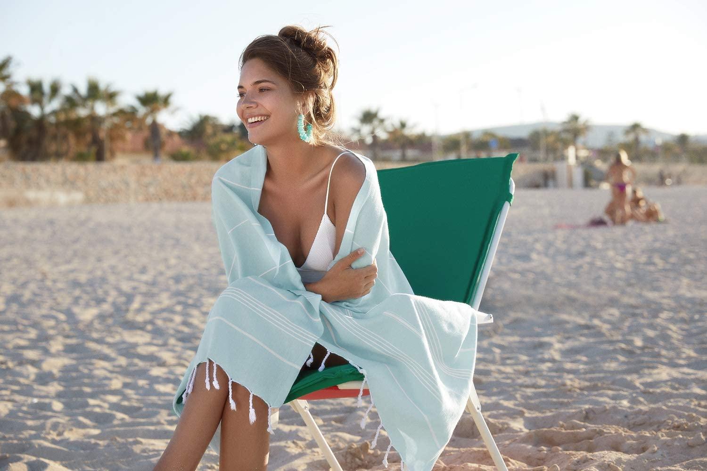 woman on beach with turkish towel