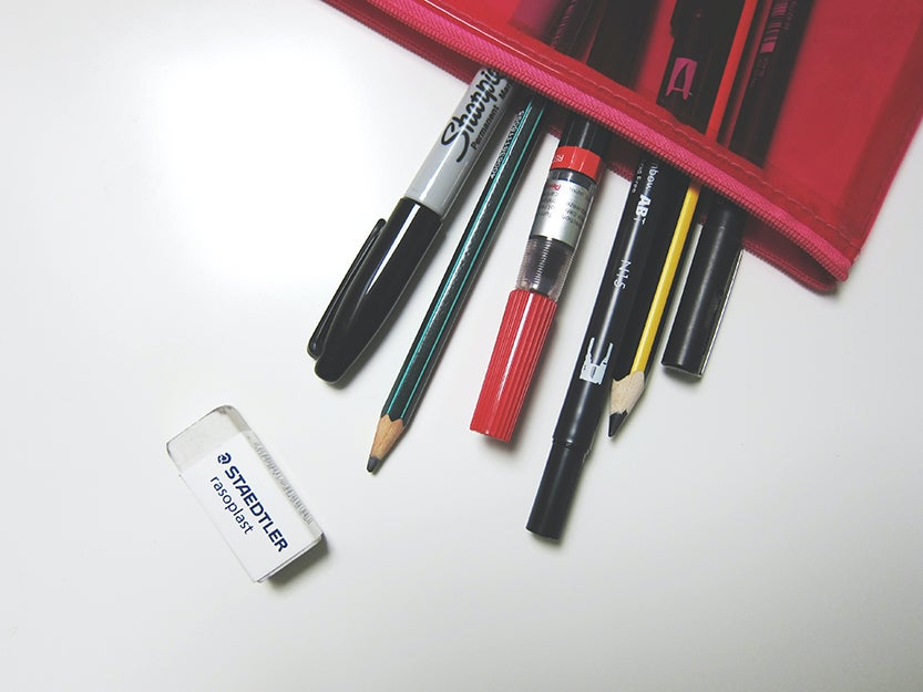pencils and pens in a case