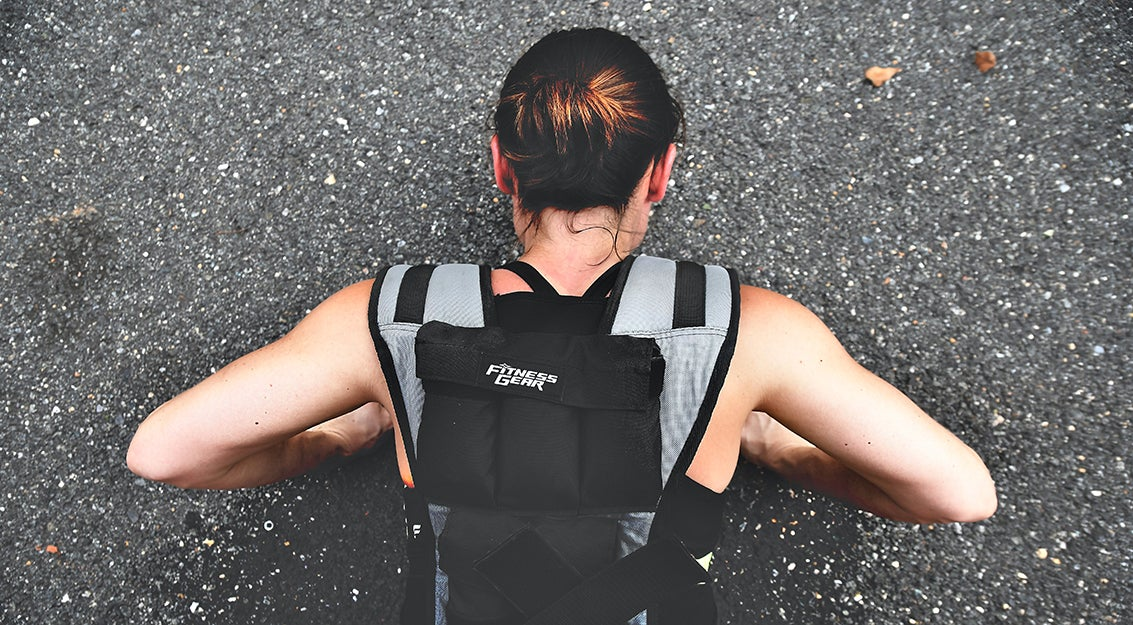 person in a weighted vest