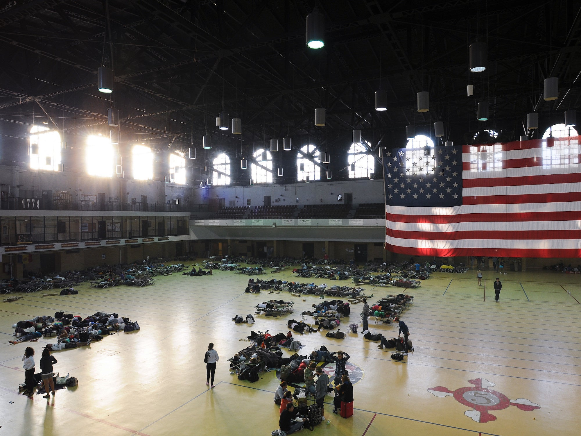 evacuees in what looks like a large gym