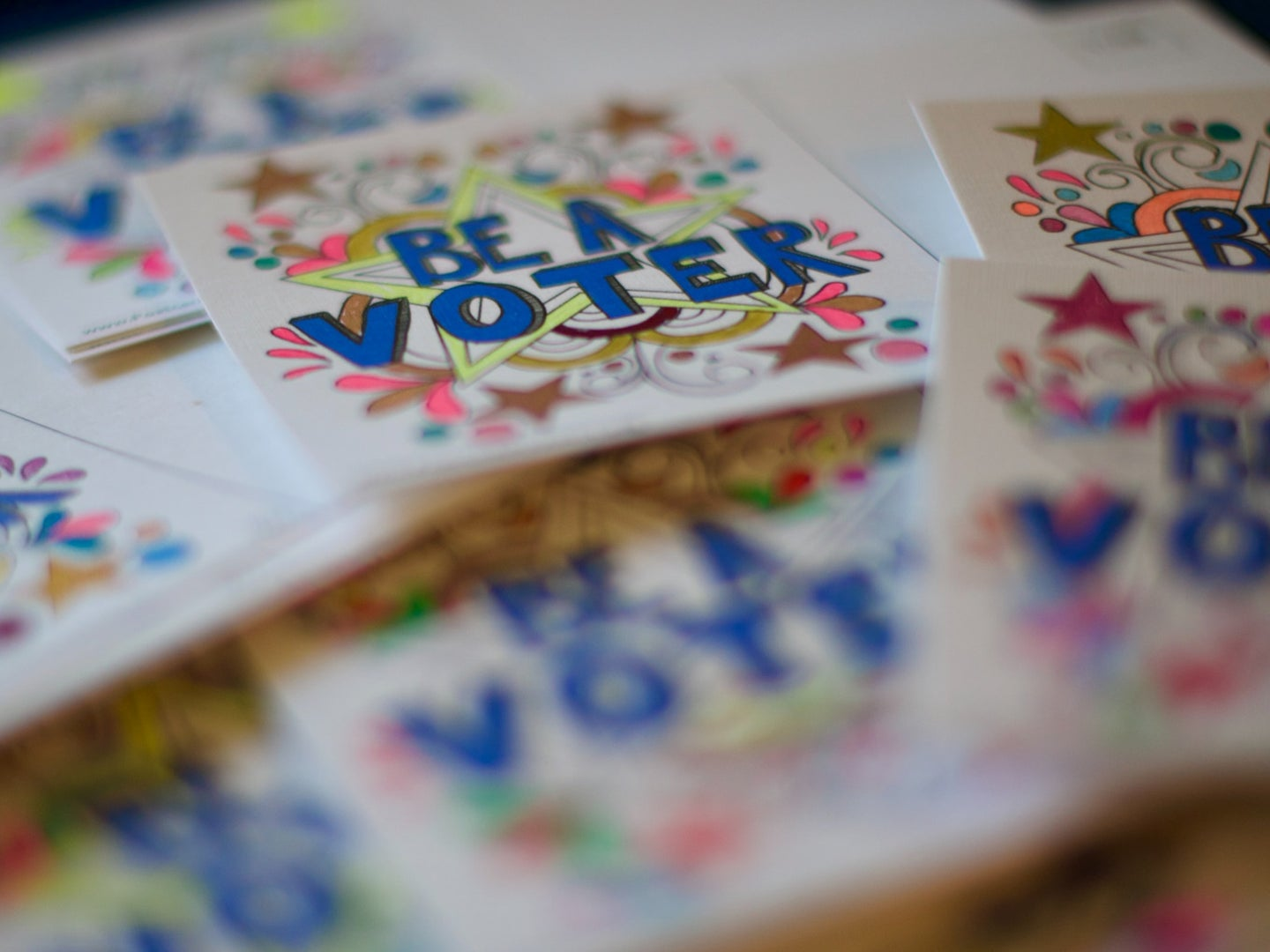 """a photo of stickers or cards that say """"be a voter"""""""