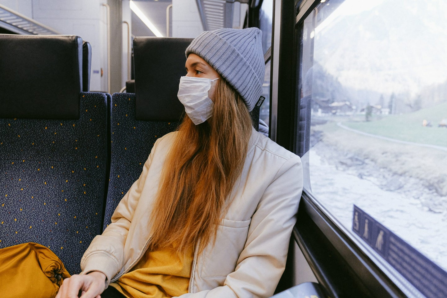 person wearing a mask on the train