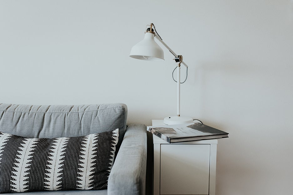 couch and side table with light on it