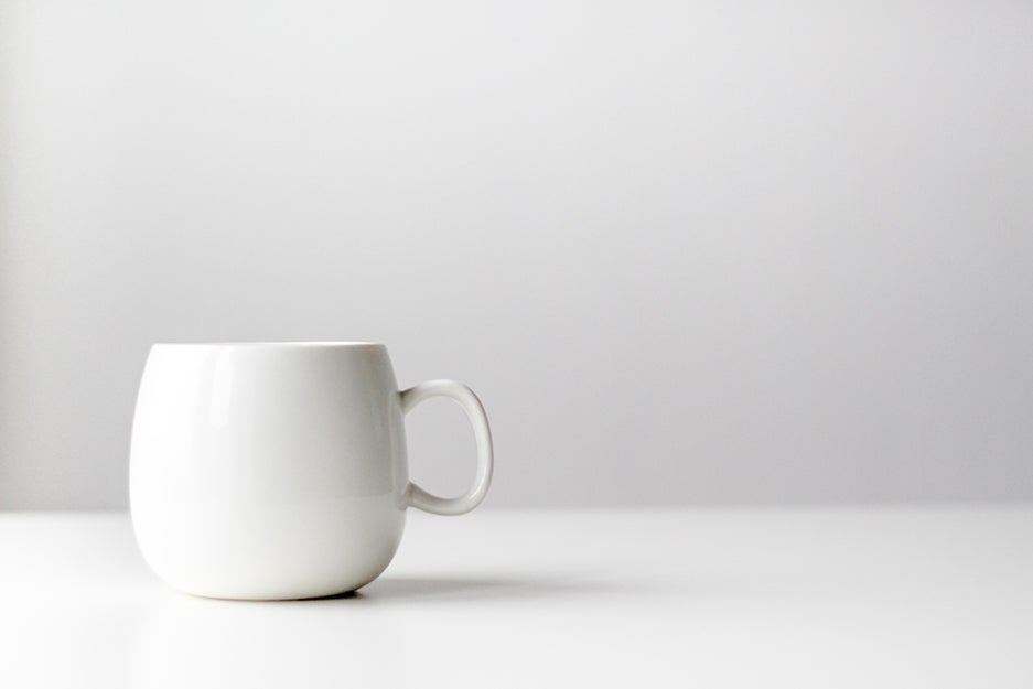 white cup on a white surface