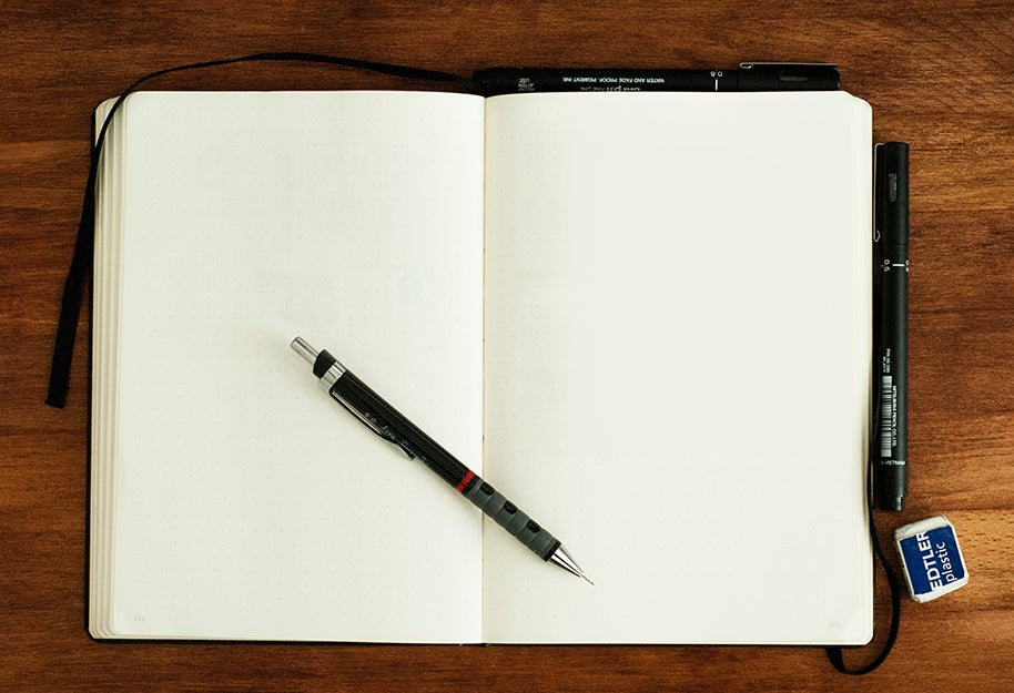 notebook with a pencil on top
