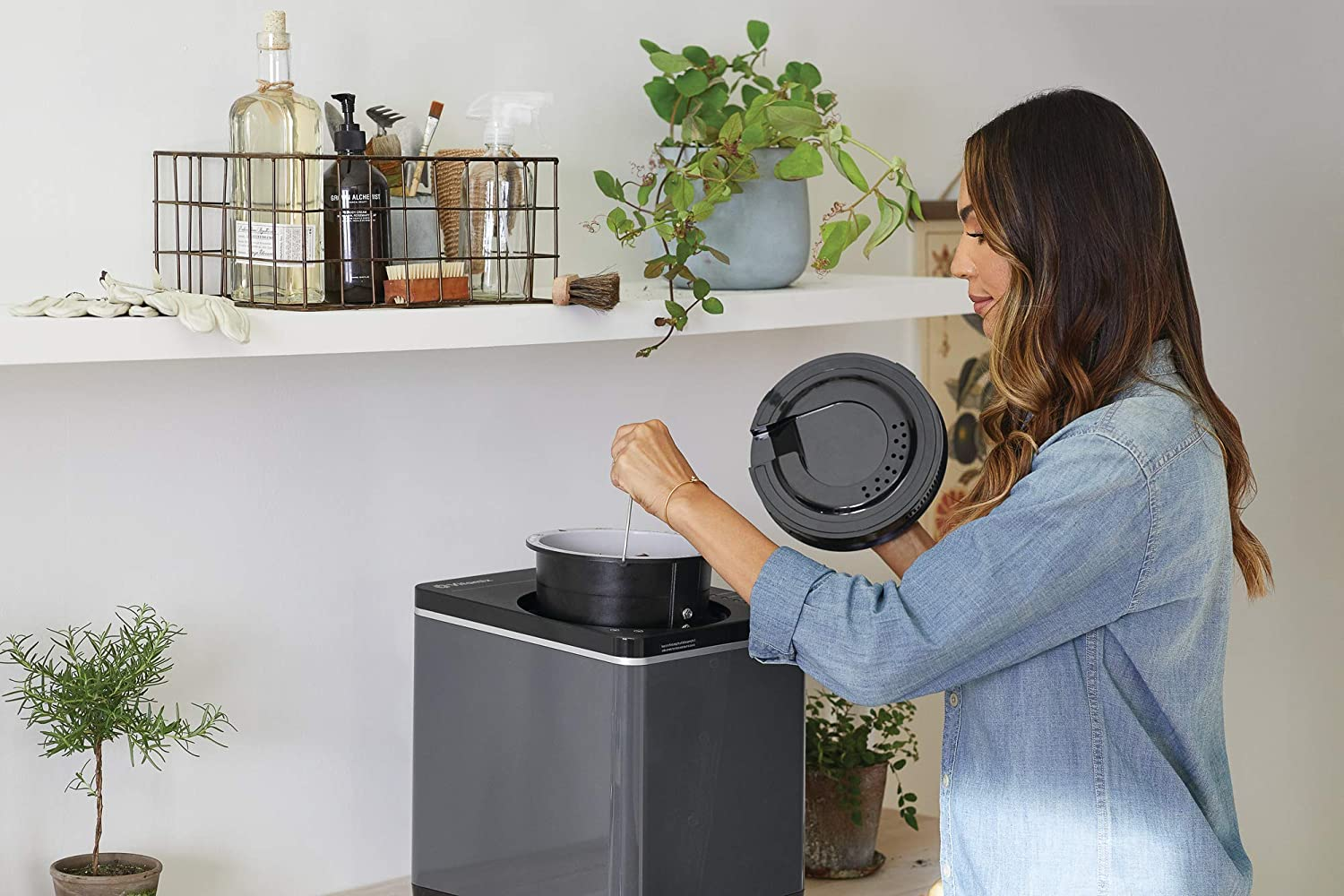 person with a composting machine