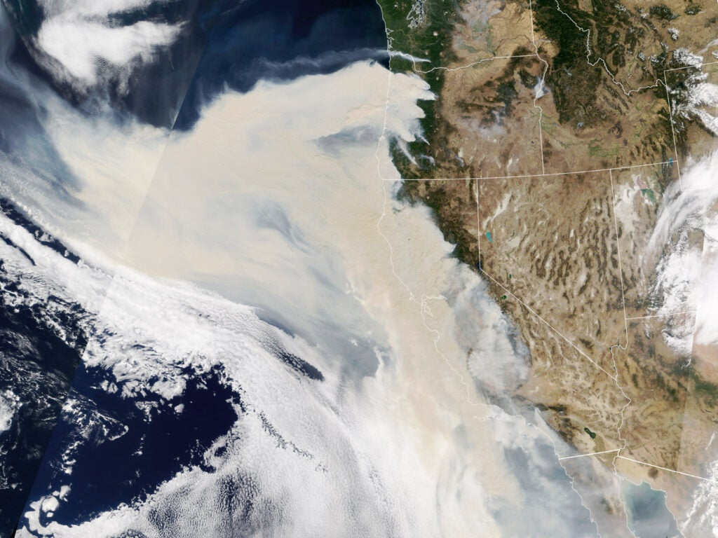 The smoke was so thick and widespread that it was easily visible from 1.5 million kilometers (1 million miles) away from Earth. When NASA's Earth Polychromatic Imaging Camera (EPIC) on NOAA's DSCOVR satellite acquired the image below, large areas of Oregon, California, and the northeastern Pacific Ocean were obscured by smoke.