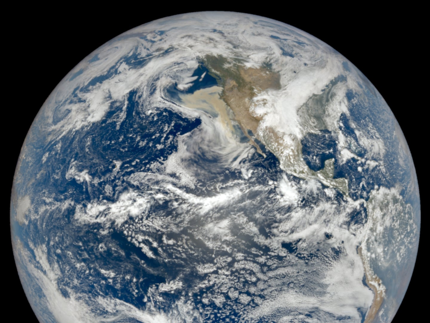 The photo was taken by NASA's camera EPIC, which takes pictures of the planet every two hour  from NOAA's satellite DSCOVR. You can spot the plume of wildfire smoke off the west coast of the United States.