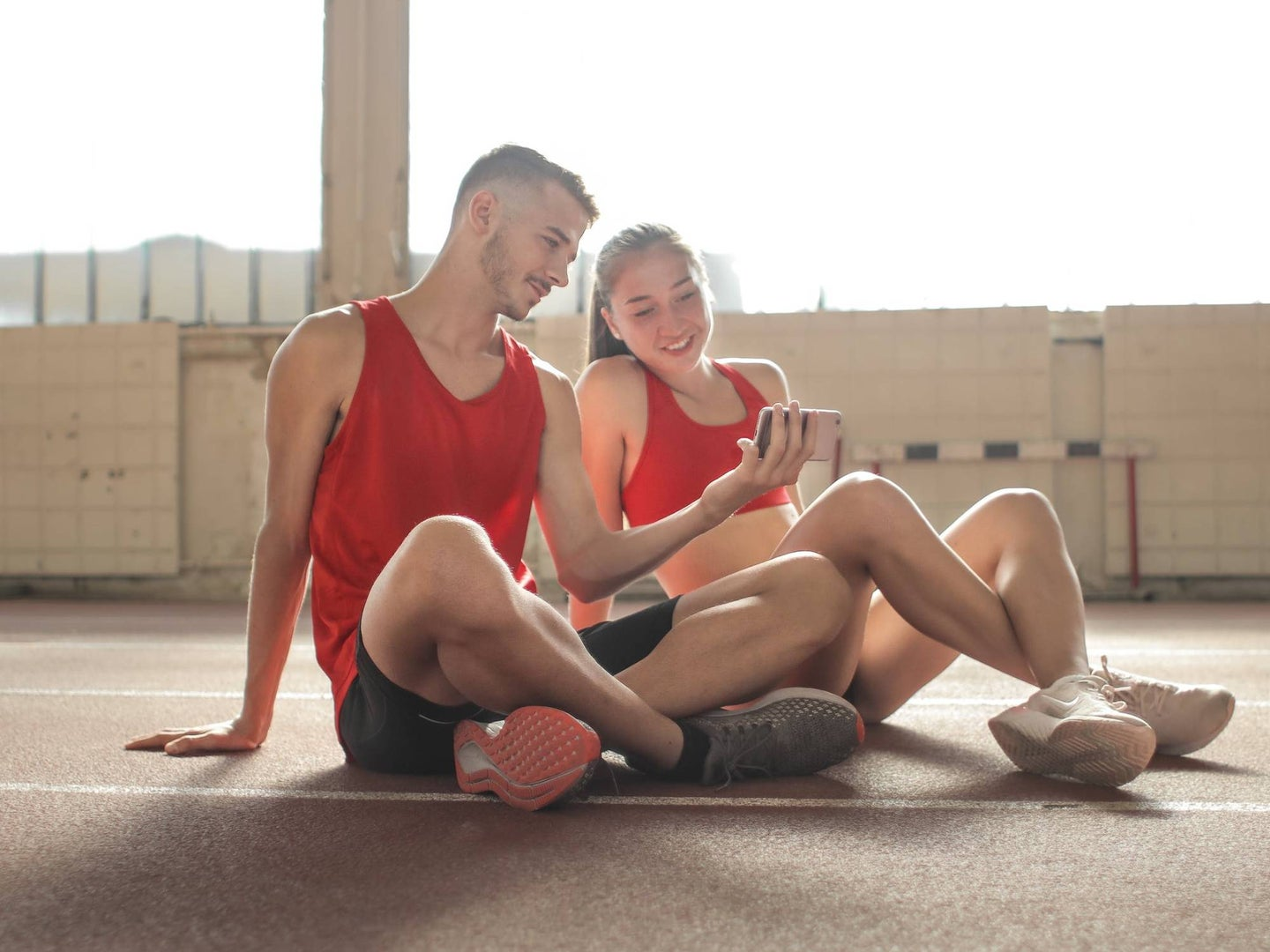 People looking at smartphone and working out