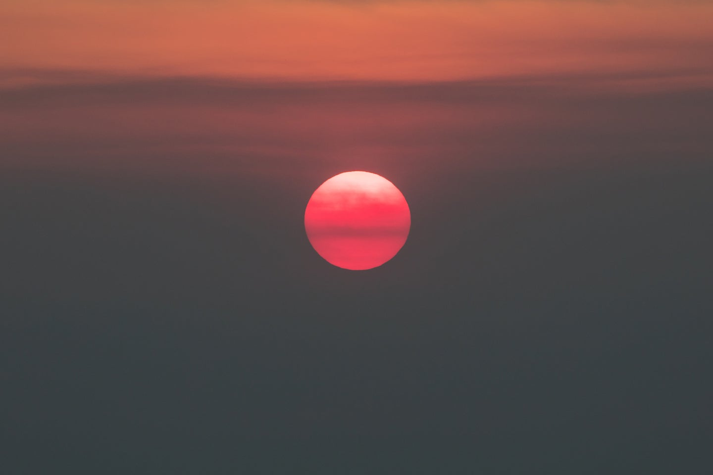 A red and orange sunset over San Francisco
