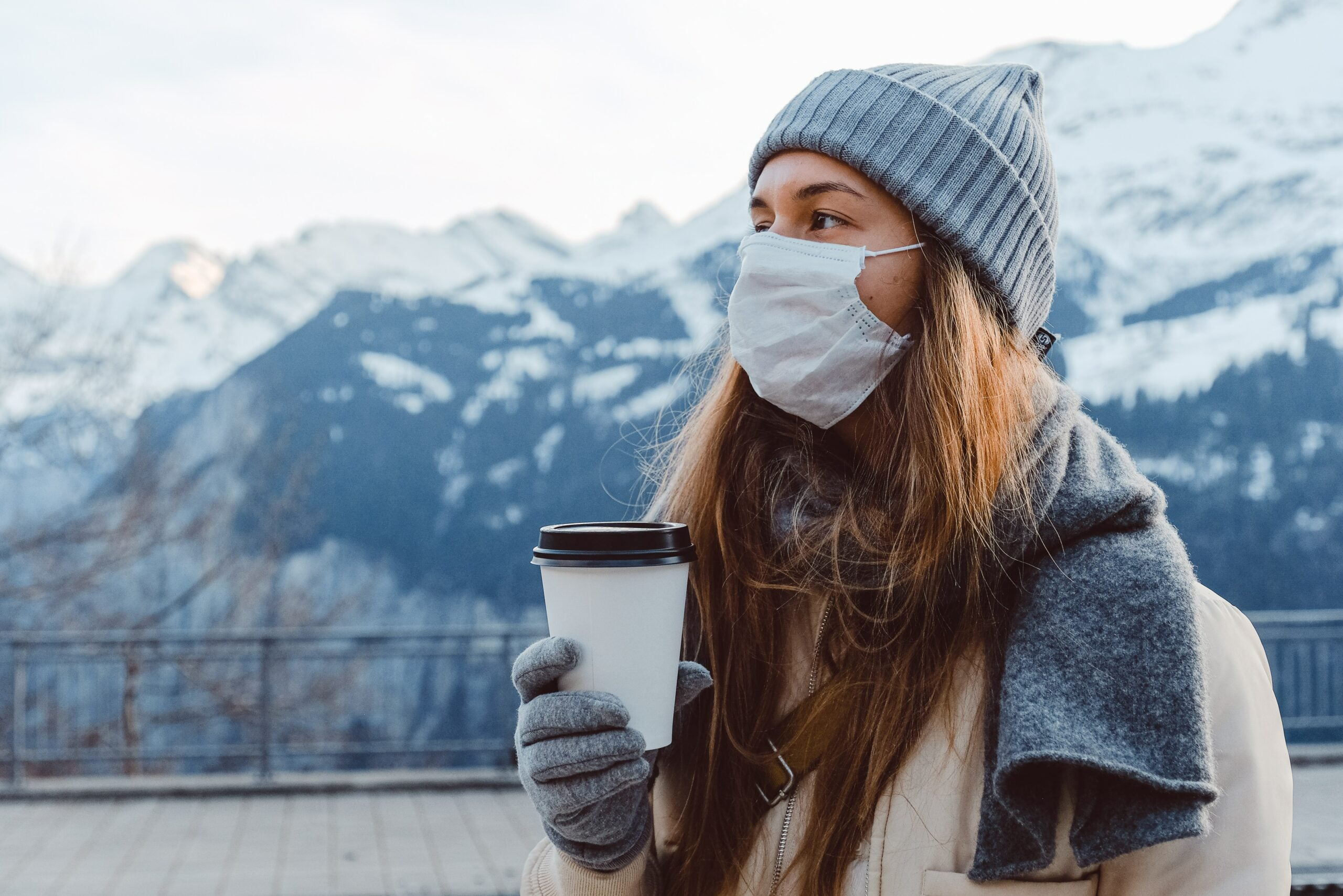 Woman in cold weather with mask.
