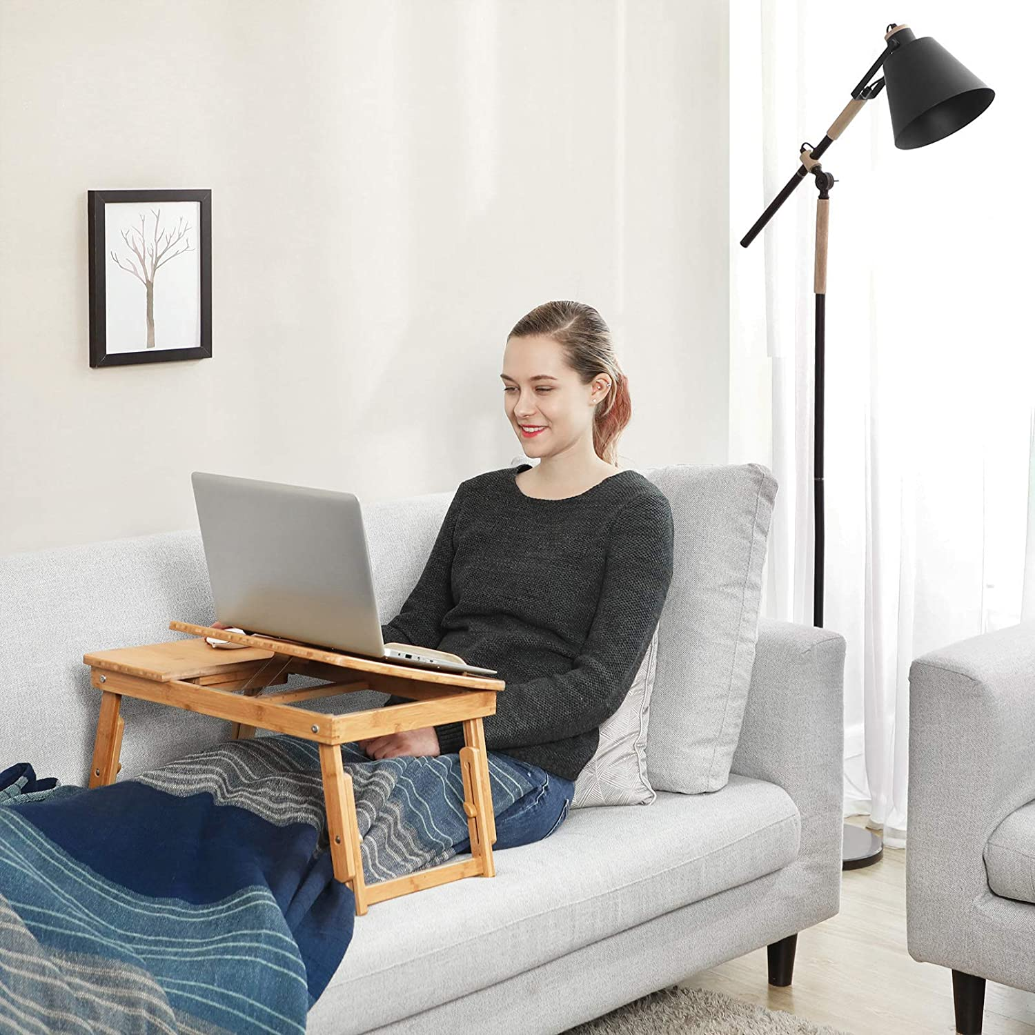 person using a lap desk on a couch