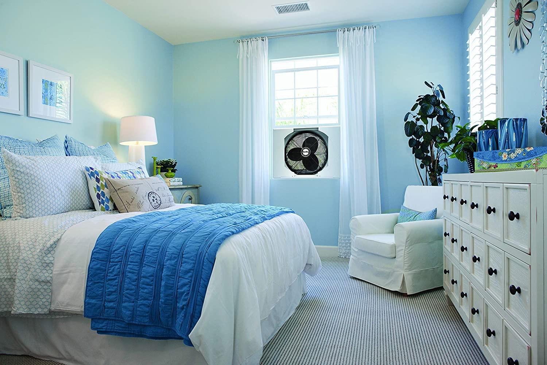bedroom with a window fan