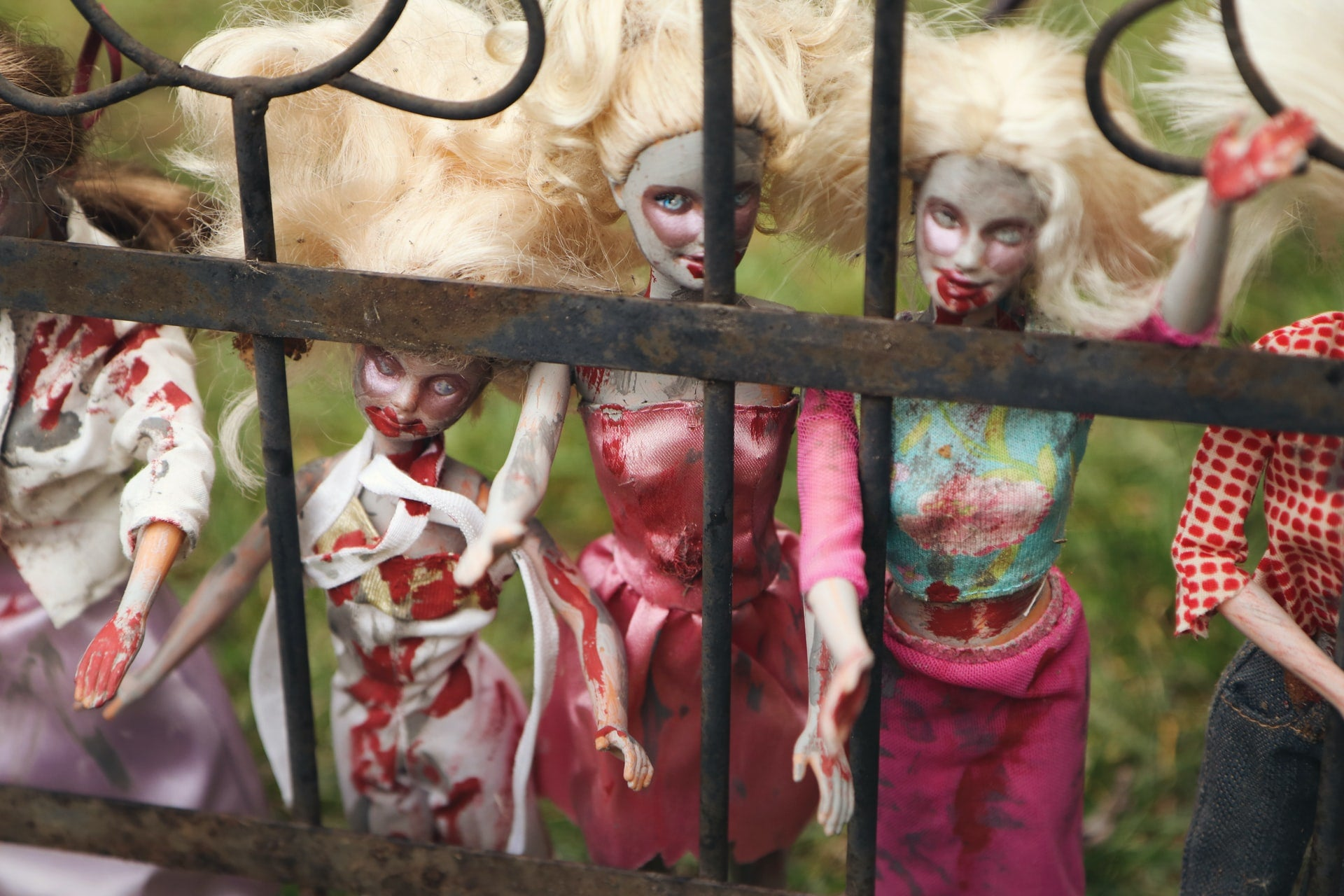 A row of Barbie dolls with fake blood